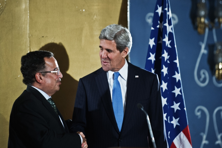 <p>US Secretary of State John Kerry (R) shakes hands with Egyptian Foreign Affairs Minister Nabil Fahmy (L) ahead of their press conference  on Nov. 3, 2013, at the Fairmont Hotel in Cairo. Kerry arrived today in Cairo to push Egypt's military-installed rulers for democratic progress, his first visit since the ouster of former President Mohamed Morsi.</p>