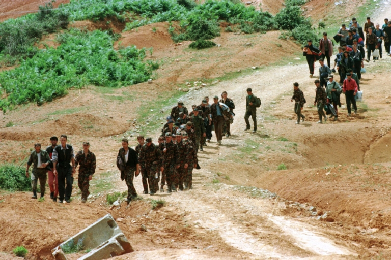 <p>Kosovo Liberation Army (KAL) combatants arrive in Albania near Tropoje after crossing the border from Kosovo in 1989.</p>
