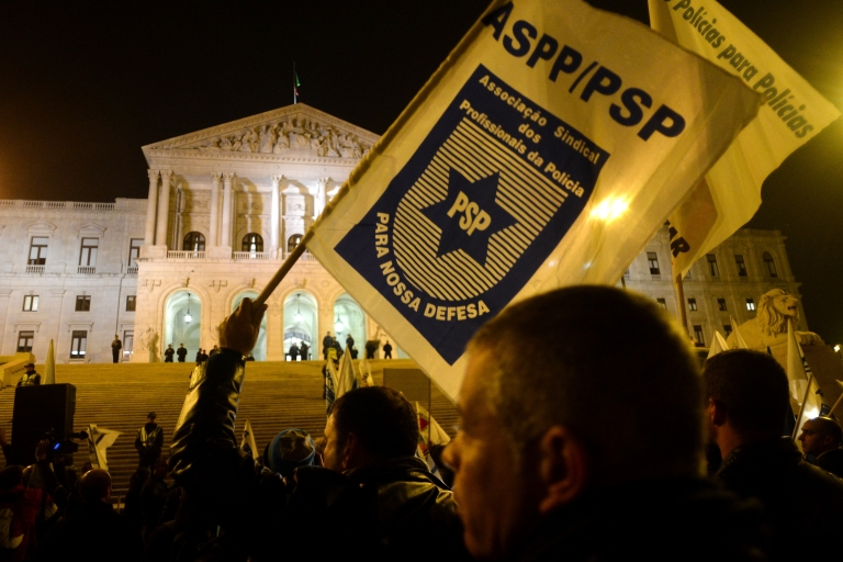 <p>Demonstrators wave police association flags outside parliament.</p>