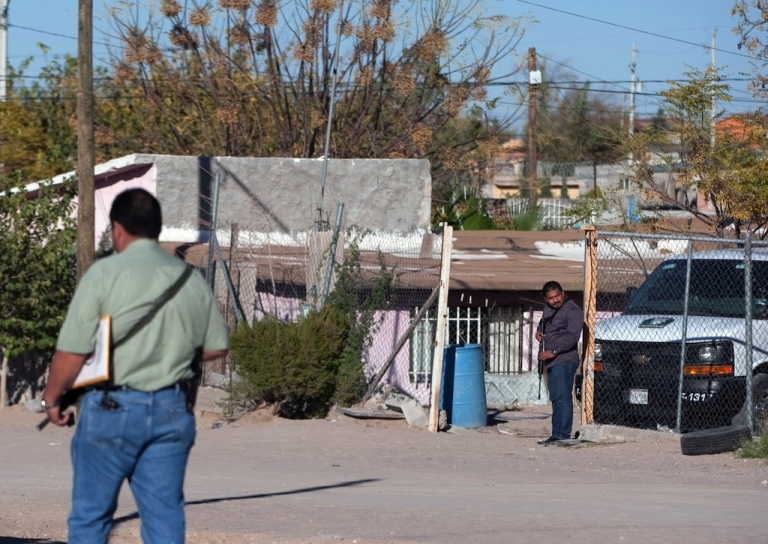<p>Mexican police guard the entrance of a house in Ciudad Juarez where eight members of the same family were found murdered on Nov. 17, 2013.</p>