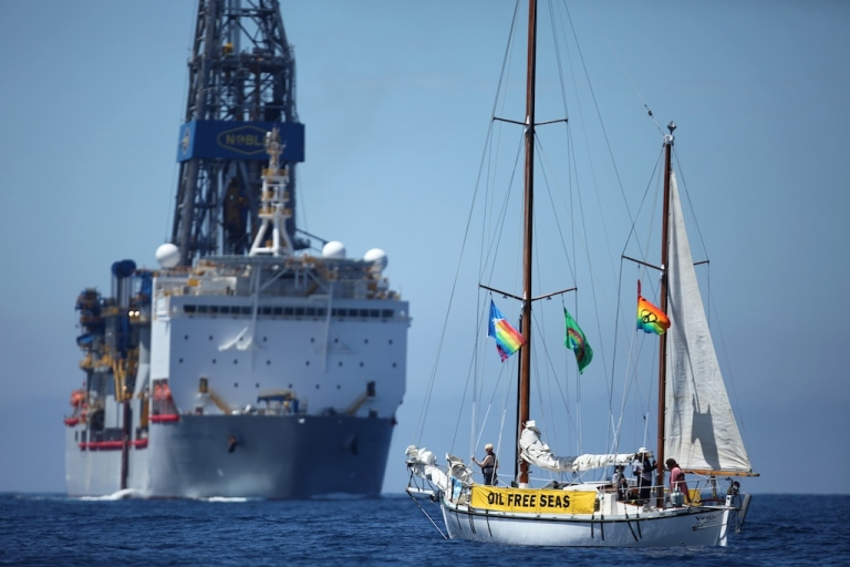 <p>Sailing vessel Vega confronts the Noble Bob Douglas drilling ship on the site where oil giant Anadarko is starting exploratory drilling for deep sea oil. The drill site is over 100 nautical miles off Raglan, on the west coast of New Zealand, and in waters about 5,000 feet deep.</p>