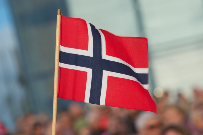 <p>A Norwegian flag is seen on the occasion of King Harald and Queen Sonja of Norway's 75th birthday celebration at Oslo Opera House on May 31, 2012 in Oslo, Norway.</p>
