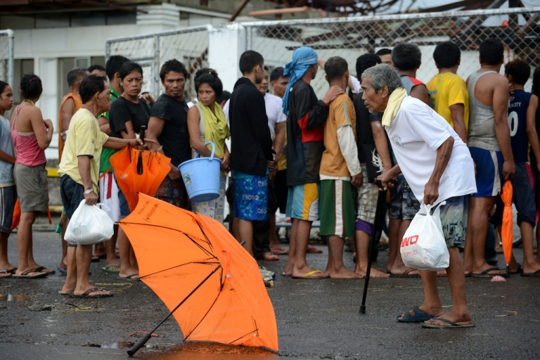 <p>Typhoon victims in Tacloban, a city on the eastern island of Leyte, line up for relief goods in the aftermath of Super Typhoon Haiyan on Nov. 9, 2013.</p>