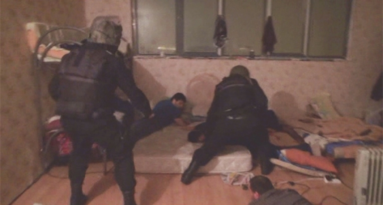 <p>A screen grab from Russia's Life News shows police arresting alleged Islamic extremists in Moscow on November 26, 2013.</p>