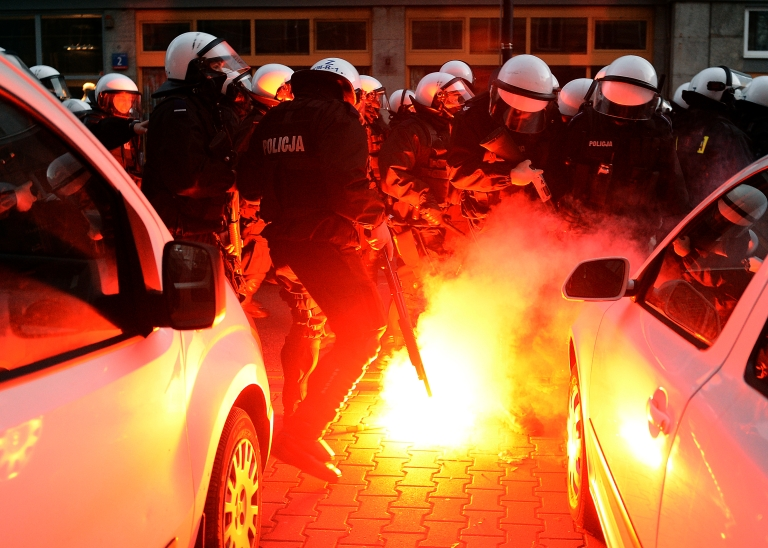 <p>Police put out fires during clashes with far-right protesters during their annual march, which coincides with Poland's national Independence Day in Warsaw on November 11, 2013.</p>