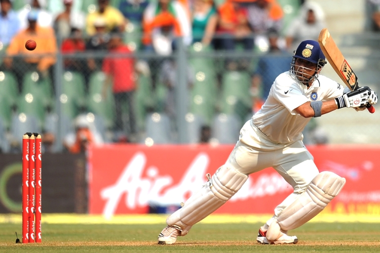 <p>Indian batsman Sachin Tendulkar plays a shot during the third Test cricket match between India and West Indies on November 24, 2011.</p>