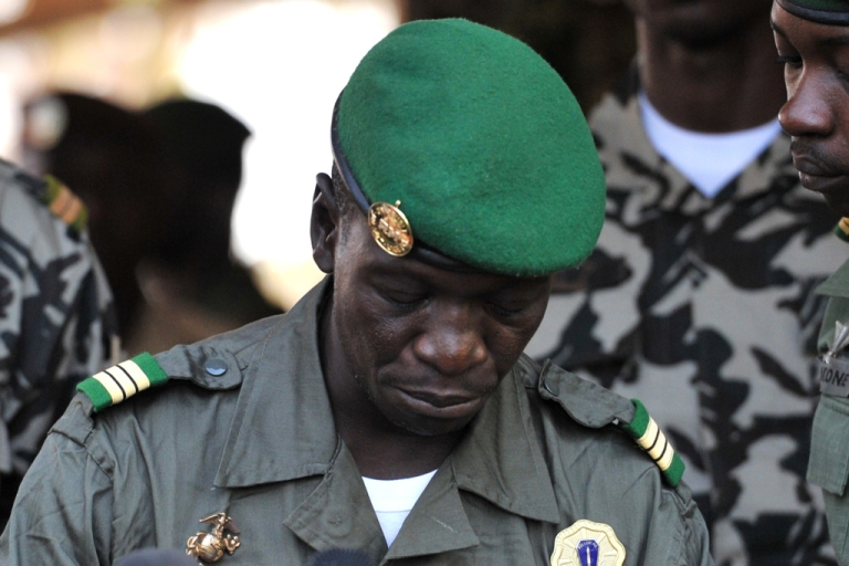 <p>Then-Capt. Amadou Sanogo speaks to reporters on April 3, 2012 at Kati military camp near Bamako, Mali.</p>