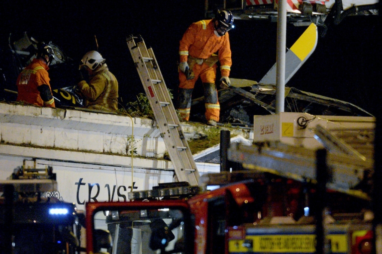 <p>Rescue workers attend the scene at a pub on Stockwell Street where a police helicopter crashed on the banks of the River Clyde November 30, 2013 in Glasgow, Scotland, United Kingdom. Police have confirmed the crash at The Clutha bar, in which multiple injuries have been reported.</p>
