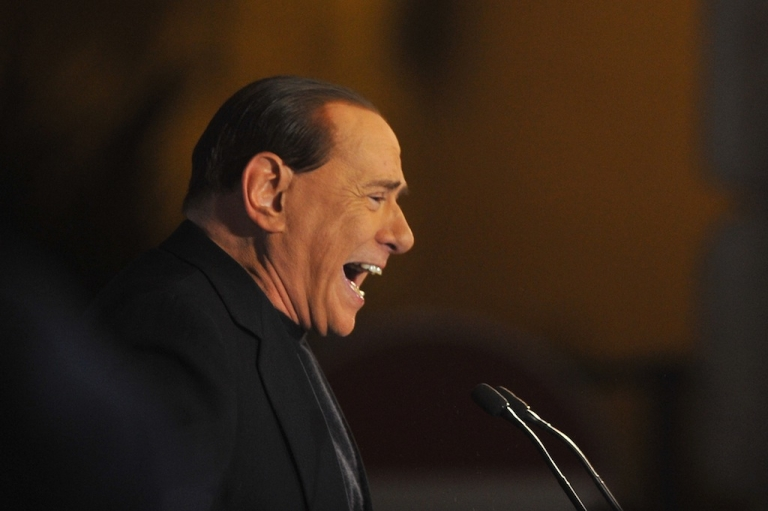 <p>Former Italian Prime Minister Silvio Berlusconi delivers a speech outside his private residence in Rome.</p>