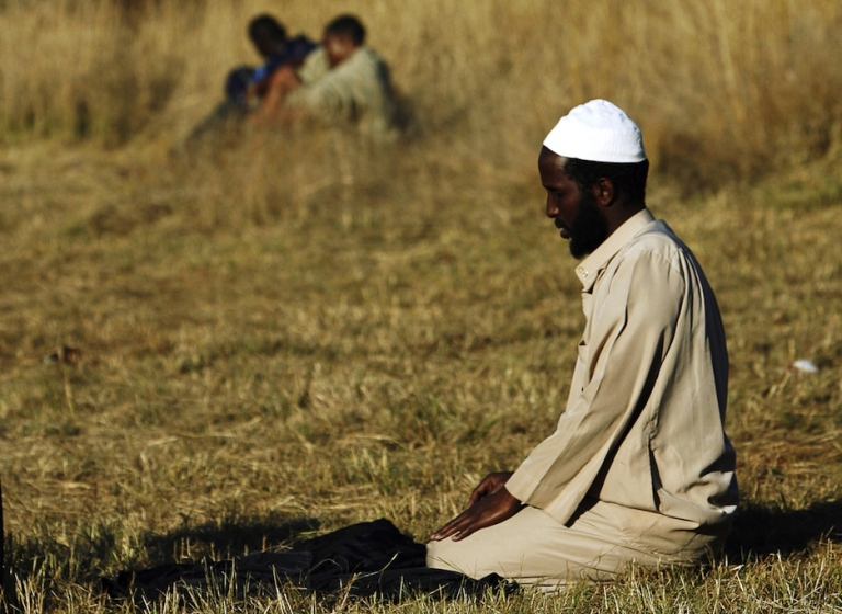 <p>A Somali muslim man prays at an informal refugee camp on the outskirts of Pretoria, South Africa.</p>