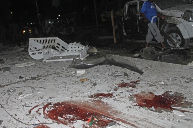 <p>A picture shows the site of a car bomb attack outside the Maka al Mukarama hotel in Mogadishu, Somalia, on Nov. 8, 2013. Around 11 people were killed in the attack at the gate of the hotel, which was hosting several VIPs at the time of the blast.</p>