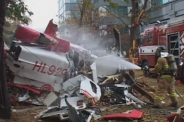 <p>A helicopter plunged to the ground in Seoul on Nov. 16, 2013, killing the two pilots after it clipped a luxury high-rise apartment building in the glitzy Gangnam district.</p>