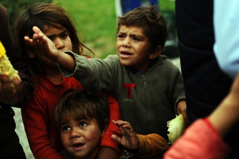 <p>Syrian children wait for food in a park where they live with their families on November 3, 2013, in Istanbul.</p>