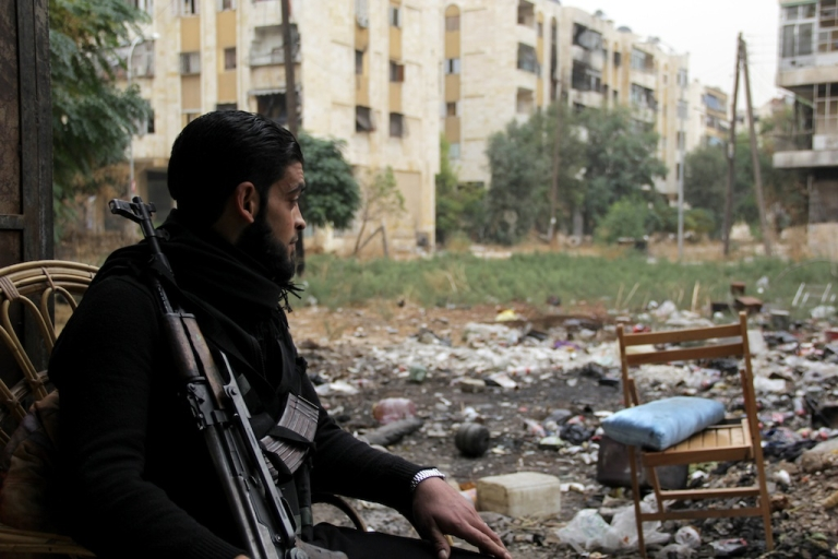 <p>A rebel fighter pictured in the northern city of Aleppo on Nov. 7, 2013. International inspectors confirmed Thursday that a chemical weapons facility in the city had been 'long abandoned.'</p>