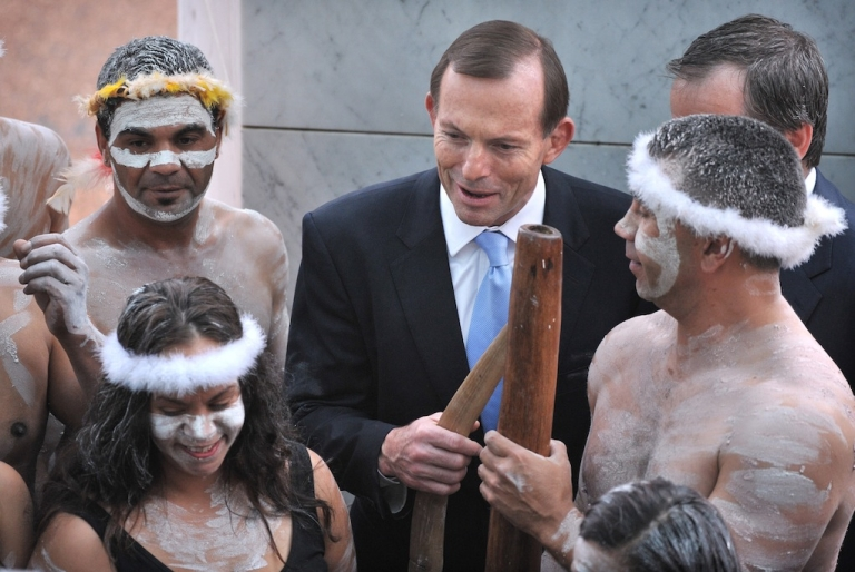 <p>Australian Prime Minister Tony Abbott holds a fighting boomerang while talking to an Aboriginal performer at the opening of the 44th Parliament in Canberra on November 12, 2013.  Some Australians say that Abbott's agenda is coming back to haunt him.</p>