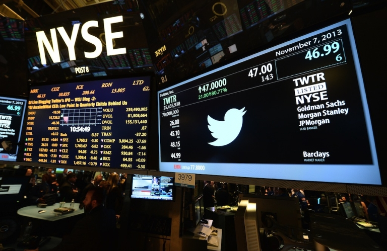 <p>A screen at the New York Stock Exchange displays the Twitter logo and share price on its first day as a publicly traded company.</p>