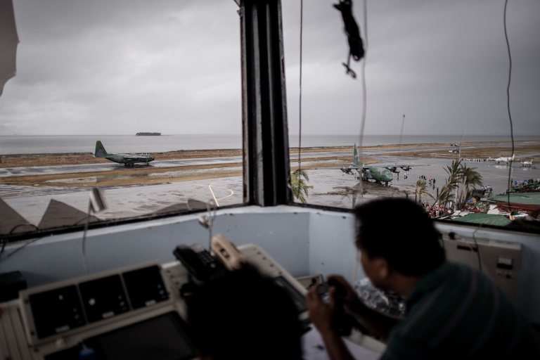 <p>A Filipino civil aviation personnel mans the damaged control tower of the airport as C-130 aircrafts take part in evacuation operations in Tacloban, on November 12, 2013 after Super Typhoon Haiyan swept over the Philippines. The typhoon that destroyed entire towns across the Philippines is believed to have killed more than 10,000 people, which would make it the country's deadliest recorded natural disaster.</p>