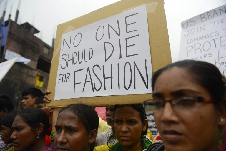 <p>Relatives of Bangladeshi workers who lost their lives in a garment factory disaster, gather with banners and placards in Savar, on the outskirts of Dhaka on June 29, 2013, at the site of Bangladesh's worst industrial disaster. Activists are set to protest across North America and Europe as they attempt to force the clothing retail giants Gap and Walmart into signing an 'Accord on Fire and Building Safety in Bangladesh', which holds corporations legally responsible for the safety of garment workers in the South Asian nation.</p>