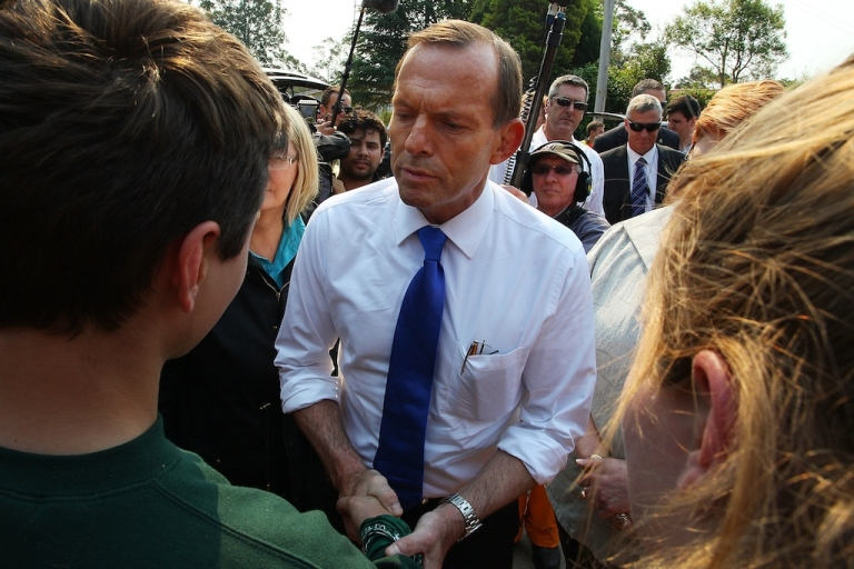 <p>Prime Minister Tony Abbott greets locals Ashley More and Spephanie Schoer at Winmalee Fire Station on October 18, 2013 in Winmalee, Australia. Abbott has staunchly maintained that climate change has not played a role in the bushfires that are sweeping New South Wales.</p>