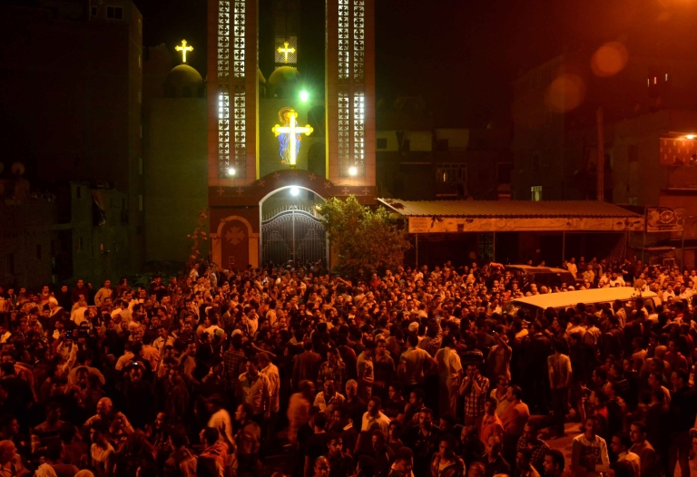 <p>Hundreds of Egyptians gather in front of the Virgin Mary Coptic Christian church in Cairo after gunmen on a motorbike shot dead three people late on October 20, 2013. Another 12 people were wounded in the first such assault targeting Christians in Cairo since the military coup that ousted Islamist president Mohamed Morsi on July 3.</p>