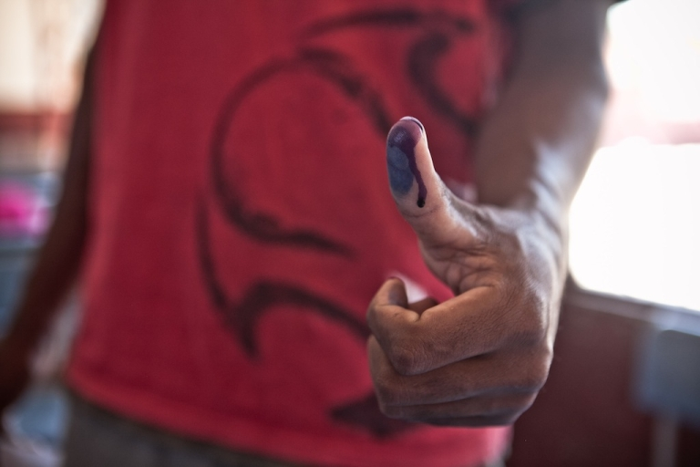 <p>A man shows his inked finger after voting at a polling station on October 25, 2013 in Tamatave, on the eastern coast of Madagascar.</p>