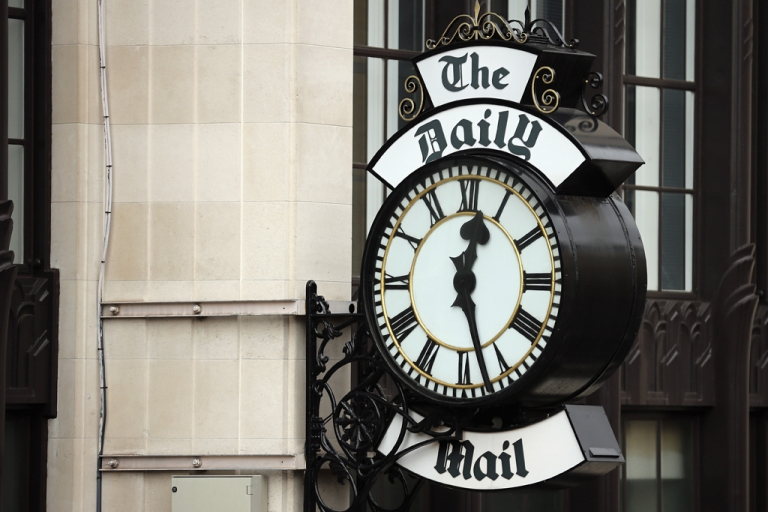 <p>A general view of a clock on the side of Northcliffe House, where the offices of British newspapers the Daily Mail and Mail On Sunday are located, on October 4, 2013 in London, England.</p>