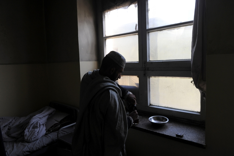 <p>An Afghan man prepares tea near his bed in a psychiatric ward of a local hospital in Kabul. Scarred by decades of war, social problems and poverty, more than 60 percent of Afghans suffer from stress disorders and mental health problems.</p>