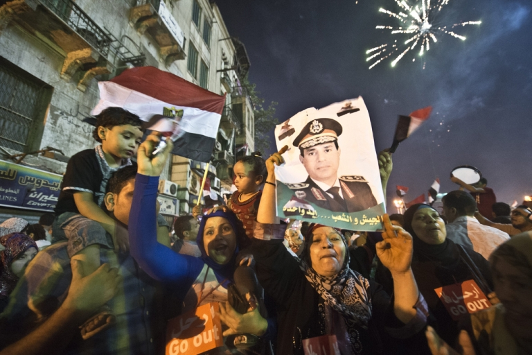 <p>People celebrate at Tahrir Square with a portrait of Army chief Abdel Fattah al-Sisi after a broadcast confirming that the army will temporarily be taking over from the country's first democratically elected president Mohamed Morsi on July 3, 2013 in Cairo.</p>