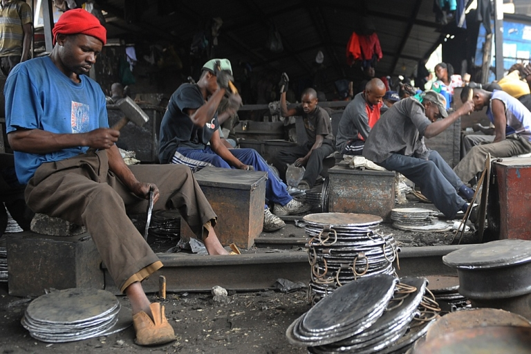 <p>Kenyan blacksmiths make frying pots that sell for $3.5o each at the Kamukunji market in Nairobi on June 20, 2012. The 2013 Afrobarometer survey of 34 countries put into sharp relief the continent's much-vaunted GDP growth rates by looking instead at the daily lives of Africans, who say they are not benefiting from economic growth.</p>