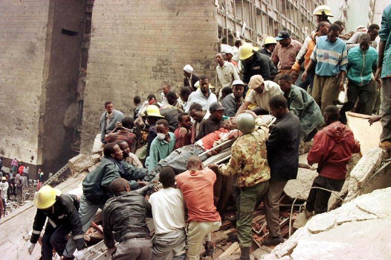 <p>Rescuers work to help survivors amid the devastation brought in by a bomb explosion in Al-Qaeda's first major international attack near the US embassy and a bank in Nairobi on August 7, 1998 that killed at least 60 people, including eight Americans, and left more than 1,000 injured.</p>