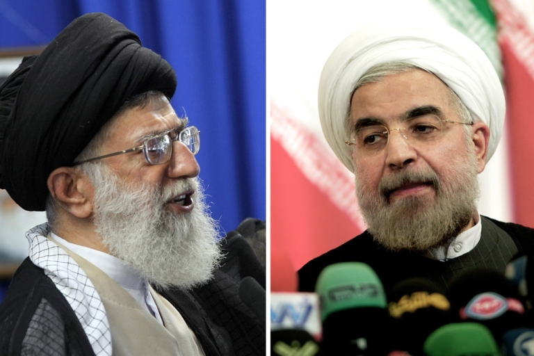 <p>Iran's supreme leader Ayatollah Ali Khamenei on the left, and the country's newly elected president, Hassan Rouhani on the right.</p>