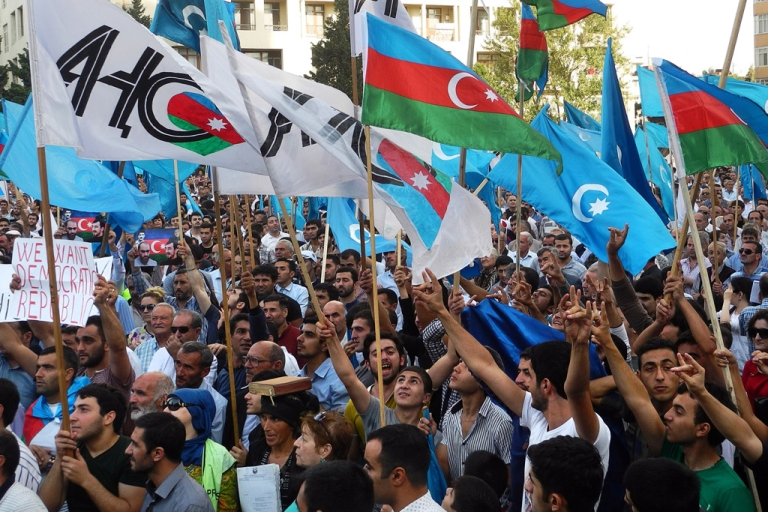 <p>Supporters of presidential candidate Jamil Hasanli gather during a rally in Baku on Sept. 22, 2013.</p>