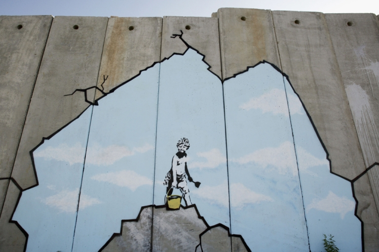 <p>A Banksy piece on Israel's West Bank barrier in Ramallah, Aug. 6, 2005.</p>