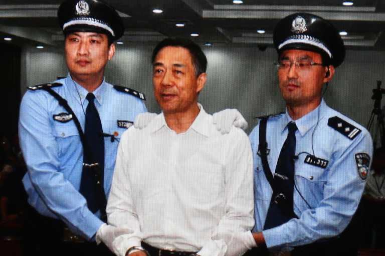 <p>A screen shows the picture of the sentence of Chinese politician Bo Xilai (Center) on September 22, 2013 in Beijing, China. The Jinan Intermediate People's Court announced Bo Xilai, former member of the CPC Central Committee Political Bureau, was sentenced to life imprisonment on Sunday for bribery, embezzlement and abuse of power.</p>