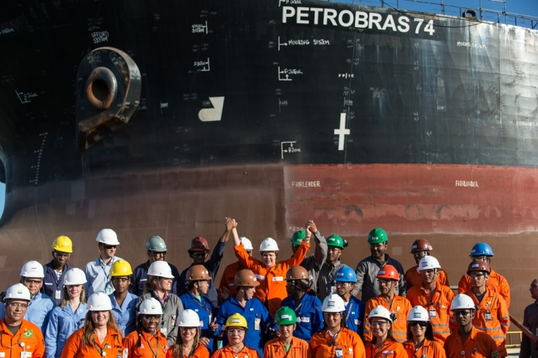 <p>Brazilian President Dilma Rousseff poses with workers of state-run oil giant Petrobras.</p>