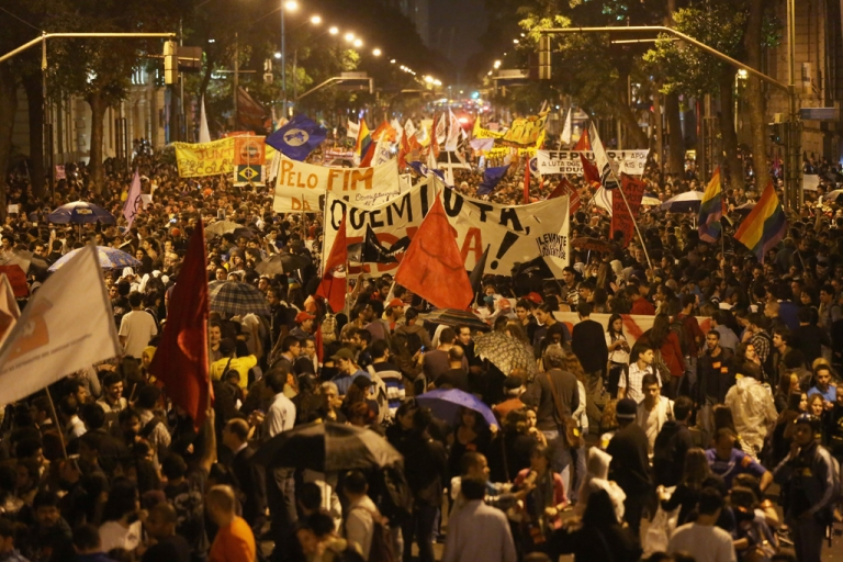 <p>Protesters  stand during a mostly peaceful demonstration by teachers and supporters calling for better public education and services on Oct. 7, 2013 in Rio de Janeiro, Brazil.</p>