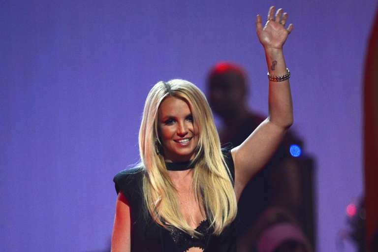 <p>Britney Spears speaks onstage during the iHeartRadio Music Festival at the MGM Grand Garden Arena in Las Vegas on Sept. 21, 2013.</p>