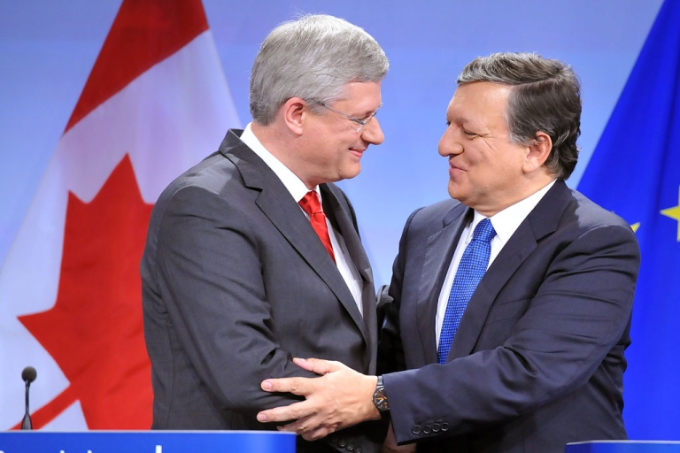 <p>Canadian Prime Minister Stephen Harper, left, and European Commission President Jose Manuel Barroso shake hands after signing a free-trade accord more than four years in the making, on October 18, 2013 at the EU headquarters in Brussels.</p>