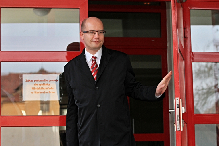 <p>Chairman of the Czech Social Democratic Party and candidate for Prime Minister Bohuslav Sobotka, leaves a polling station in Austerlitz, after casting his ballot on October 25, 2013.</p>
