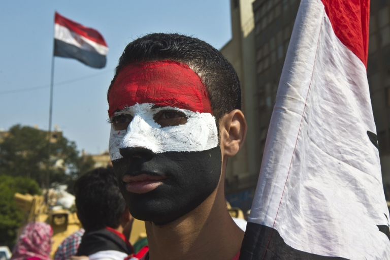 <p>A youth with his face painted the national colors of Egypt as the country marks the 40th anniversary of the 1973 Arab-Israeli war on October 6, 2013.</p>