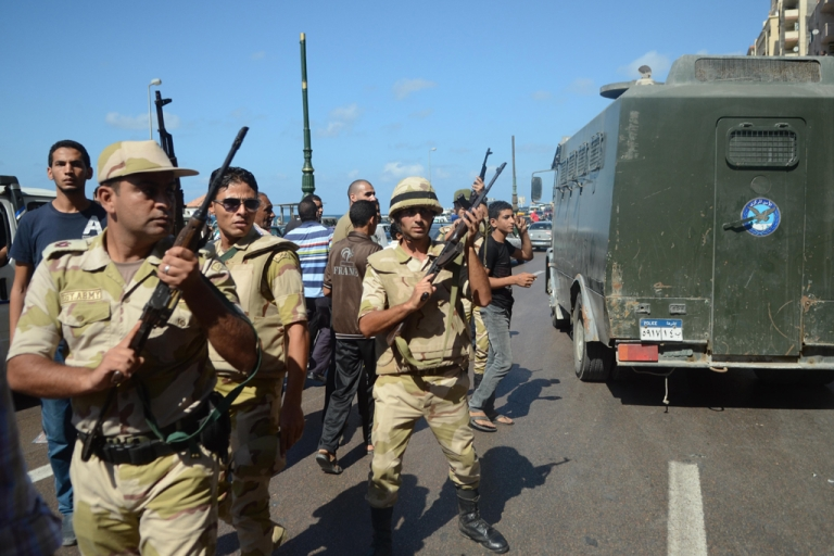 <p>Egyptian security forces take position during a demonstration in support to Egypt's ousted Islamist president Mohamed Morsi and against the military on September 20, 2013 along the seafront in northern coastal city of Alexandria. Clashes were again reported on October 4, 2013 in several Egyptian cities.</p>