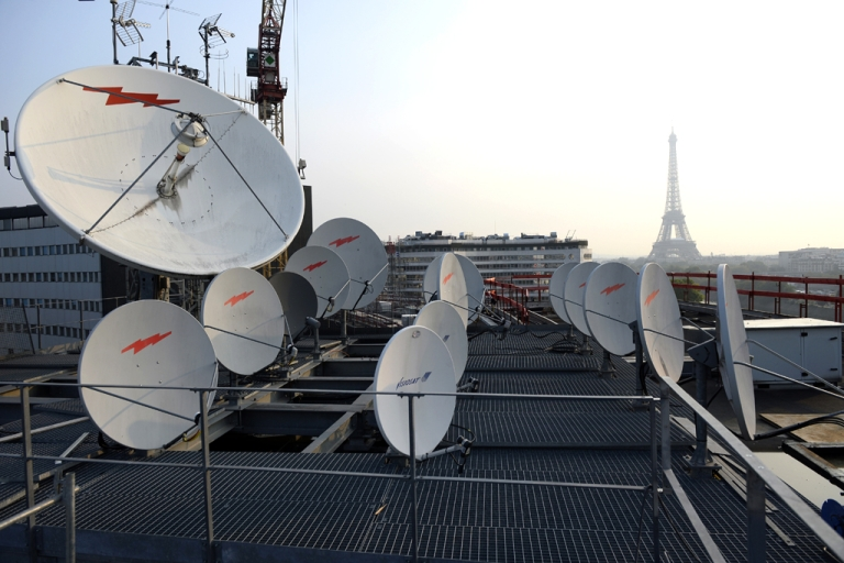 <p>Antennas and satellite dishes, in front of the Eiffel tower in Paris, France.</p>