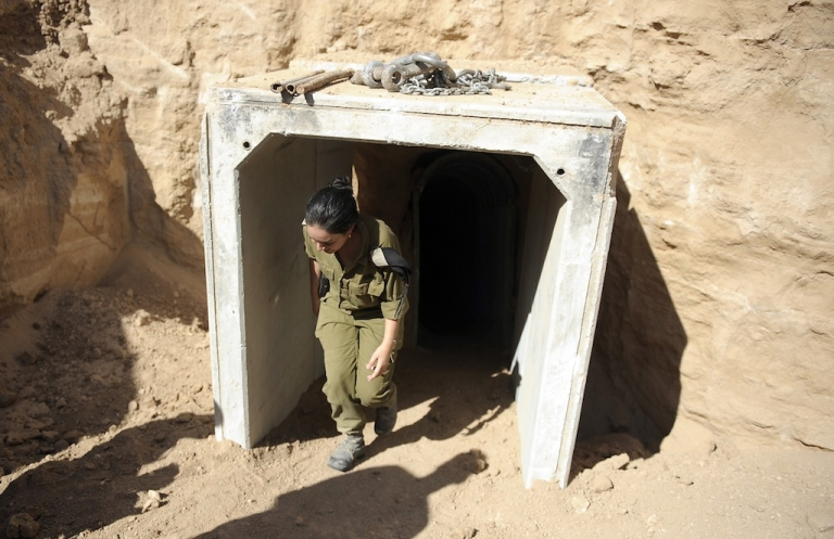<p>An Israeli soldier exits the entrance of a tunnel allegedly dug by Palestinians beneath the border between the Gaza Strip and Israel and recently uncovered by Israeli troops, on October 13, 2013.</p>