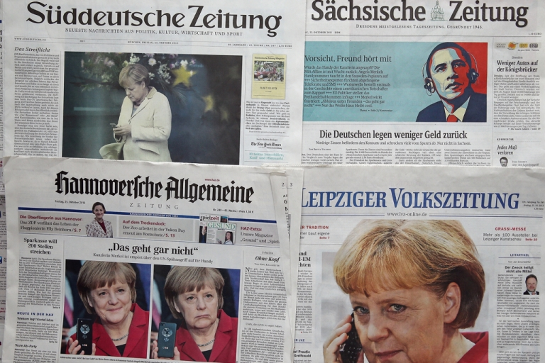 <p>German newspapers with front page photos referring to the NSA eavesdropping of German Chancellor Angela Merkel's phone scandal on October 25, 2013 in Berlin, Germany.</p>
