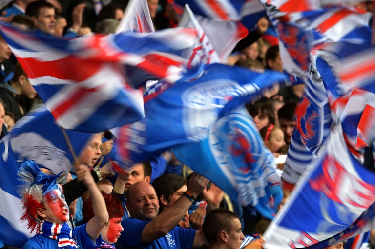 <p>Rangers fans wave the Union Jack. A hard core of supporters are helping perpetuate sectarianism.</p>