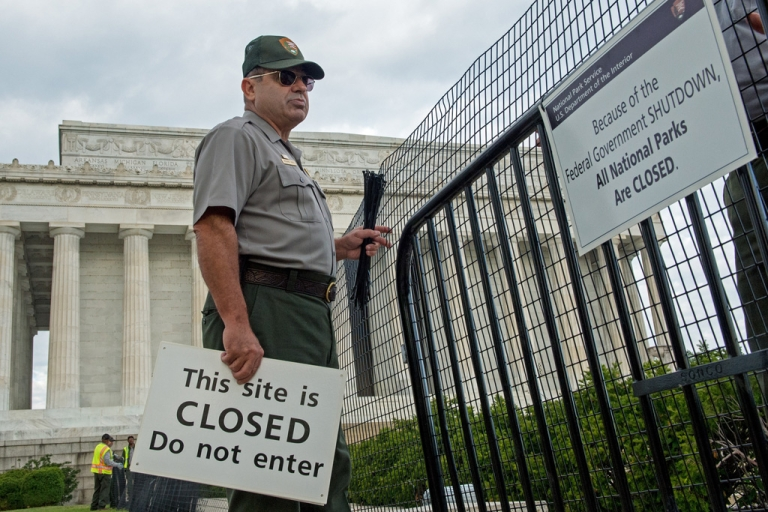 <p>US Park Service workers fence off the closed Lincoln Monument in Washington, DC, as the first US Federal government shutdown since 1995 begins.</p>