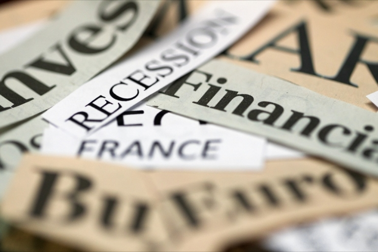 <p>A picture taken on June 8, 2012 in Paris, shows words cut from newspapers to illustrate recession, crisis and financial situation in Europe. T</p>