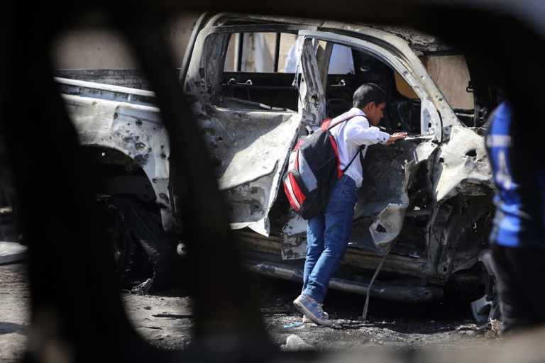 <p>An Iraqi boy inspects a burnt-out vehicle following a suicide attack the previous night in Baghdad's eastern al-Jadidah district, on October 7, 2013. Violence in Iraq has reached a level unseen since 2008, amid persistent fears of a relapse into the kind of intense Sunni-Shiite bloodshed that peaked in 2006-2007 and killed tens of thousands of people.</p>