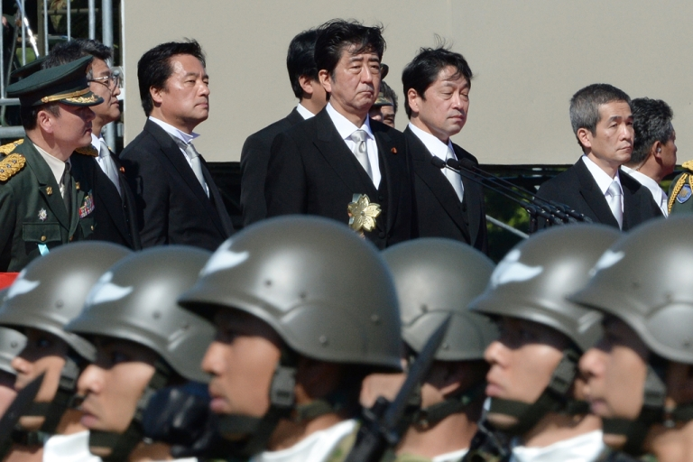 <p>Japanese Prime Minister Shinzo Abe (top C) inspects troops of Japan's Self-Defence Force during a military review on October 27, 2013.</p>