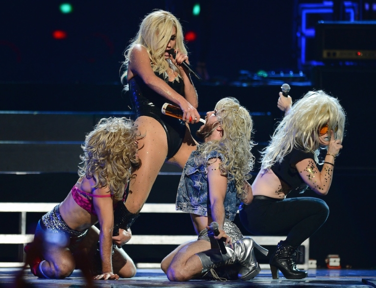 <p>Ke$ha pours whipped cream into a dancer's mouth during a performance at the iHeartRadio Music Festival at the MGM Grand Garden Arena on Sept. 21, 2013 in Las Vegas, Nevada.</p>